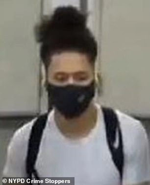 The NYPD is searching for a man (pictured) acussed of kicking a womanin the chest on a subway station escalator on Thursday night, causing her to fall several feet
