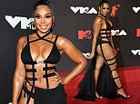 Ashanti, 40, exposes her toned physique in a bondage inspired outfit at the 2021 MTV VMAs