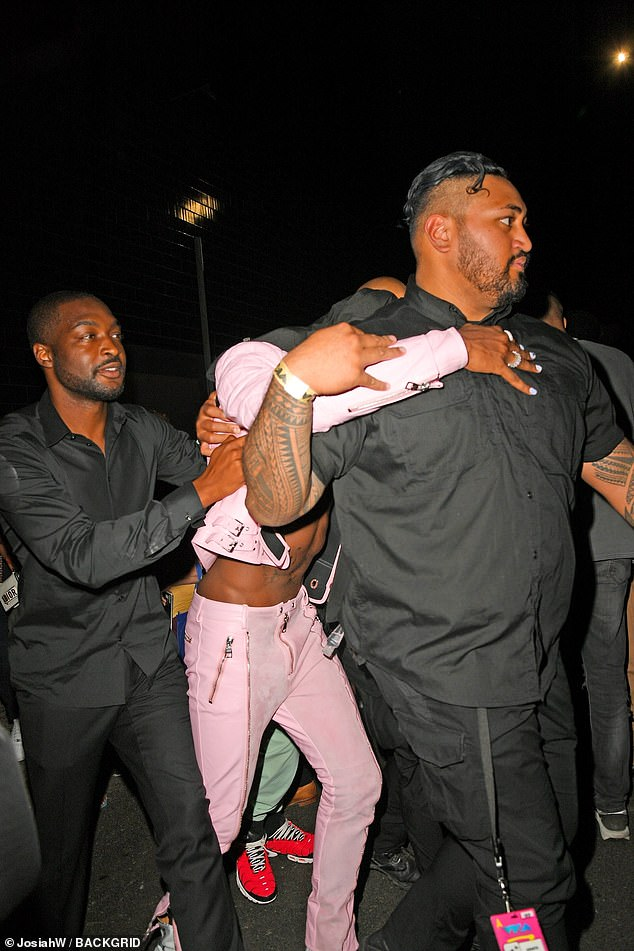Oh dear:Lil Nas X, 22, wasn't shy about celebrating his VMAs win, with the rapper looking worse for wear while being propped up by bodyguards at an afterparty held at 1OAK