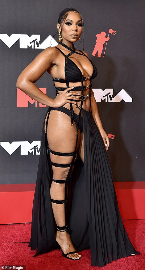 Jaw-dropping: Ashanti's gown boasted gold accents and she boosted her height with a black pair of barely-there stilettos