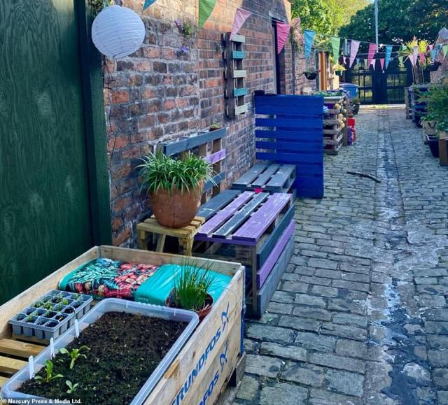 The alleyway in Merseyside used to be a place where the residents would just dump their bins - but now the street gathers