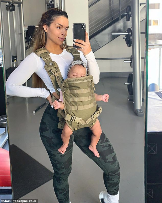 On the go! Niki pictured with Aria at the gym shortly after her daughter's birth. She said it took her a year following Aria's birth to achieve her body goal