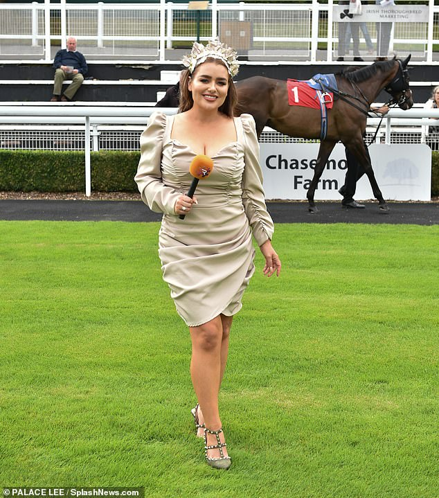 Busy bee:On Friday, she anchored from #Raceday at Sandown Park Racecourse in Surrey where she judged the Best Turned Out Award and handed prizes to the winners