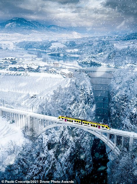 This beautiful image is highly commended in the Urban category, with photographer Paolo Crocetta behind the lens. It shows a small train known as The Vaccanonesa, which connects the Italian city of Trento with the villages of Val di Non and Val di Sole in the province of Trentino, crossing a breathtaking gorge at a height of over 150 metres (500ft)
