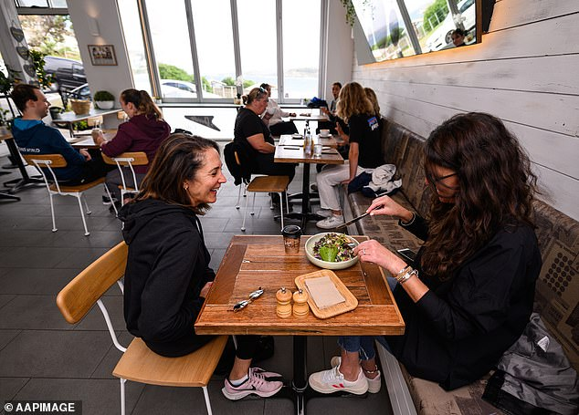 Businesses which allow unvaccinated customers through their doors or hire staff who are not fully vaccinated against Covid-19 will face 'significant fines,' the NSW government has warned (pictured, Speedo's Cafe in Sydney's Bondi Beach on after the first lockdown in May 2020)