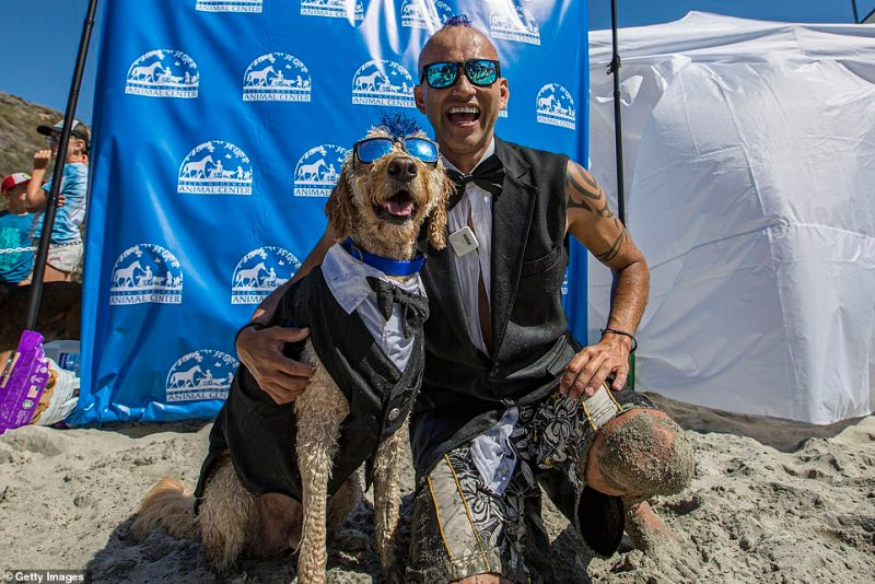 Kioni Russell Gallahue and his surfing partner Derby pose prior to competing in Sunday's festivities