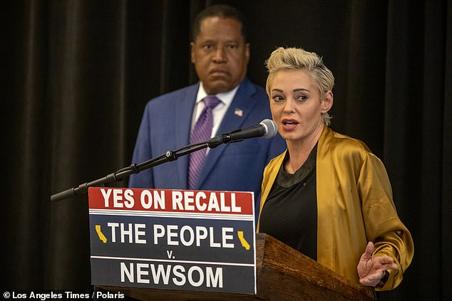 Rose McGowan (front), a leading figure in the #MeToo movement, accused the wife of Larry Elder's (back) opponent, Governor Gavin Newsom, of trying to silence her about movie producer Harvey Weinstein