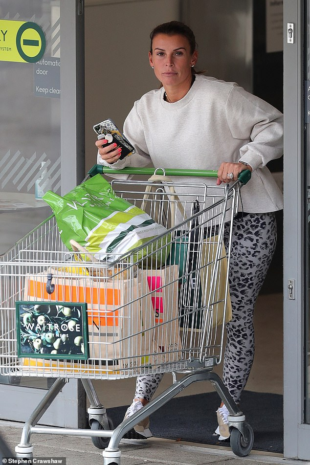 Wild side:The original WAG kicked off her week by stocking up on groceries at her local Waitrose, while clad in eye-catching leisurewear