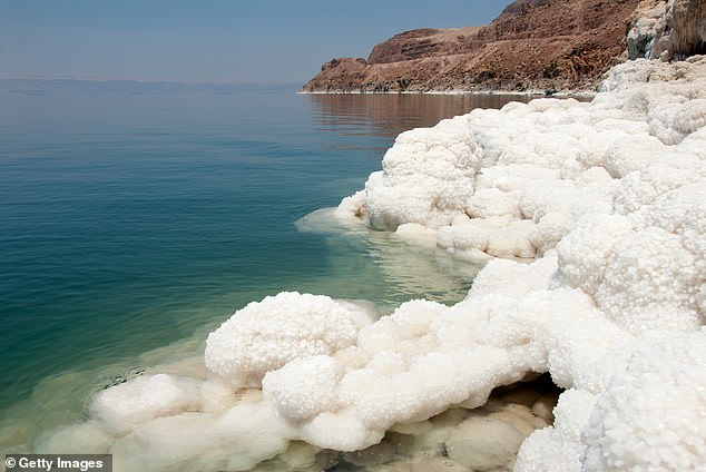 As a large body of salt water, the shores of the Dead Sea glitter with crystallized sodium chloride
