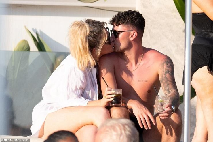 Drinks in hand: The pair enjoyed a tipple while snogging