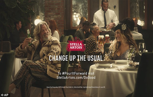 Still working hard: Here he is seen with Sarah Jessica Parker in a Stella Artois ad