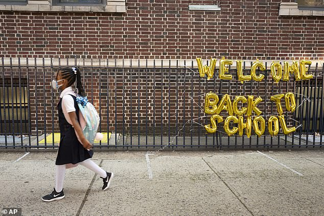 More than 250,000 children tested positive for the virus in the week ending September 2.  The opening weeks of the school year have been particularly devastating as classes are disrupted in more than 1,000 schools across the country due to the virus.  Pictured: A girl in New York City attends the first day of school on September 13