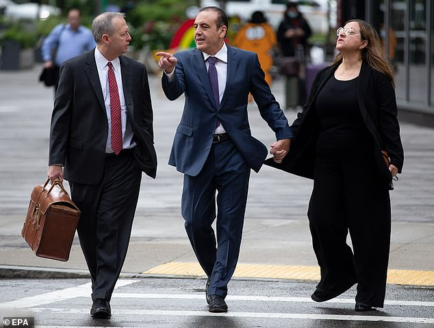Aziz (center) allegedly agreed in 2018 to pay $300,000 to secure his daughter's admission to USC as a basketball recruit by bribing an official