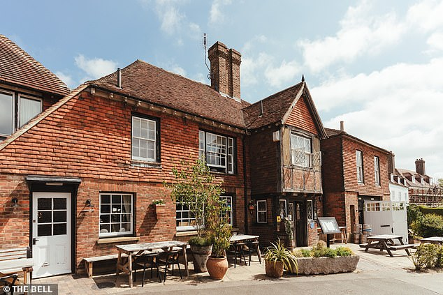 Pictured above is East Sussex's The Bell, which Harry describes as a 16th-century 'palace of a pub'