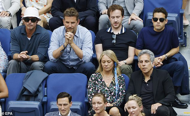 Different angle: Ben and his wife Christine Taylor sat in front of Brad, Bradly and Rami Malek (far right)
