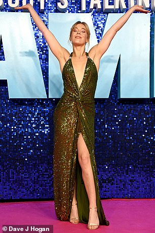 Wow: Also in attendance at the event was Becky Hill who cut a glamorous figure in a dark green dress with a plunging neckline