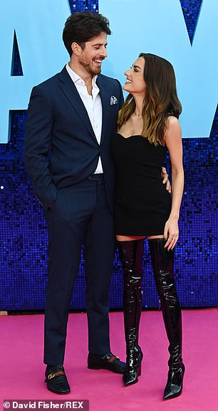 Romance: It appears that the couple have decided to reunite as they put on a loved-up display at the premiere