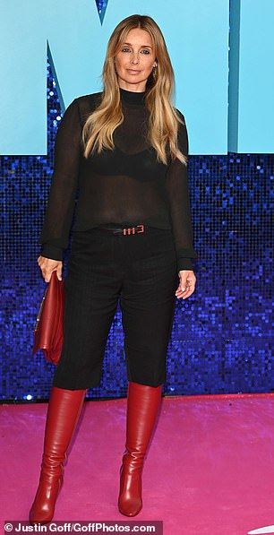 Eye-catching: Louise styled her blonde locks into loose waves for the premiere