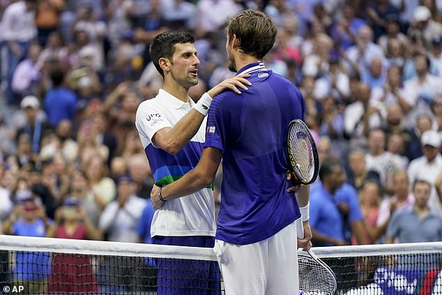 Djokovic (left) would have held all four Grand Slams had he managed to secure victory