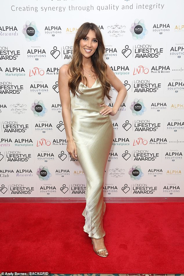 Golden goddess:Seen in a gorgeous gold silk gown was alongside her famous mum was daughter Lucy, who appeared on ITV's The Voice in 2017