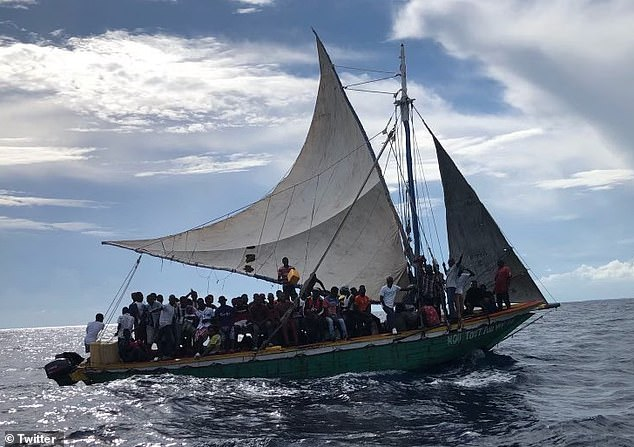 The U.S. Coast Guard stopped a 35-foot boat with 104 Haitian migrants after the vessel was spotted in Florida waters on Sunday