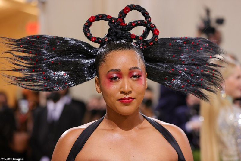 Osaka's hair was coiffed into a bizarre pretzel-shaped updo with huge fan-shaped pieces jutting out from either side of her head, which left her looking more like the guest at a Halloween party than a glittering celebrity gala