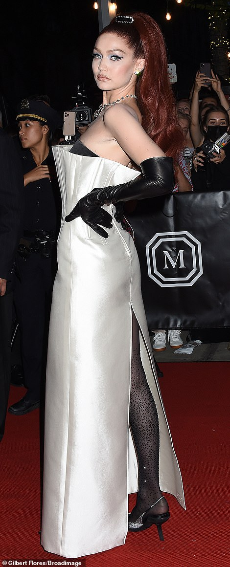 Gigi Hadid wowed in a black and white strapless Prada gown with tights
