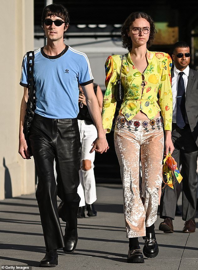 Ella confirmed her relationship with GQ editor Sam, 27, in August. Above, the pair is pictured outside the Collina Strada show on Thursday in Brooklyn