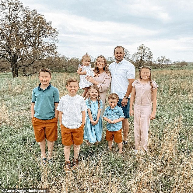 Anna Duggar has supported her husband through his legal battle - and Josh is allowed to see their children when she is present while he awaits trial (family pictured)