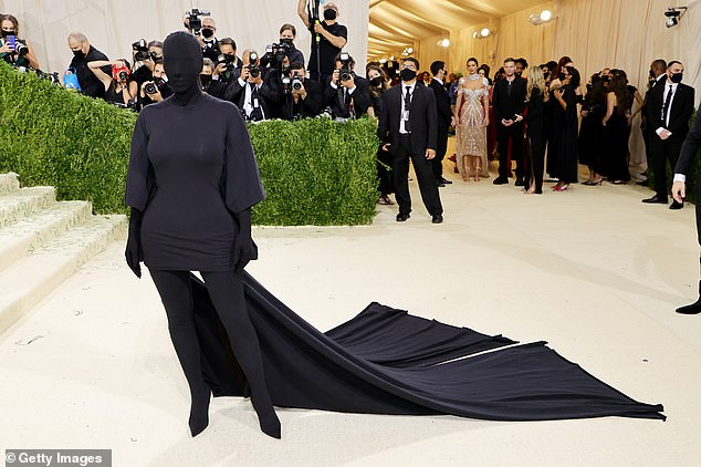 Keeping it simple: Kim Kardashian completely covered up her face in an all-black head-to-toe Balenciaga ensemble including balaclava as she arrived at The Metropolitan Museum of Art in New York City on Monday