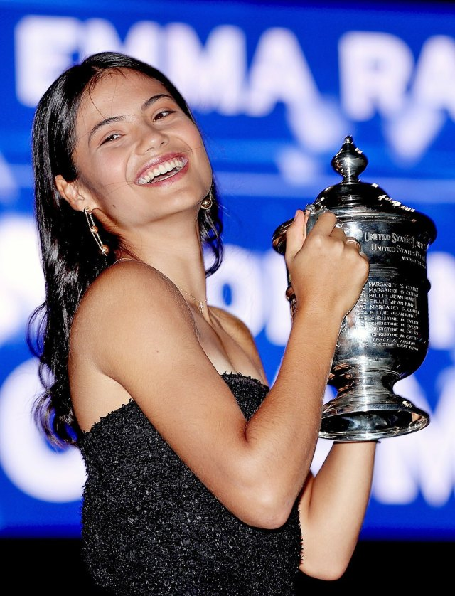Emma Raducanu proudly holds the trophy for the US Open after winning the final on Saturday night