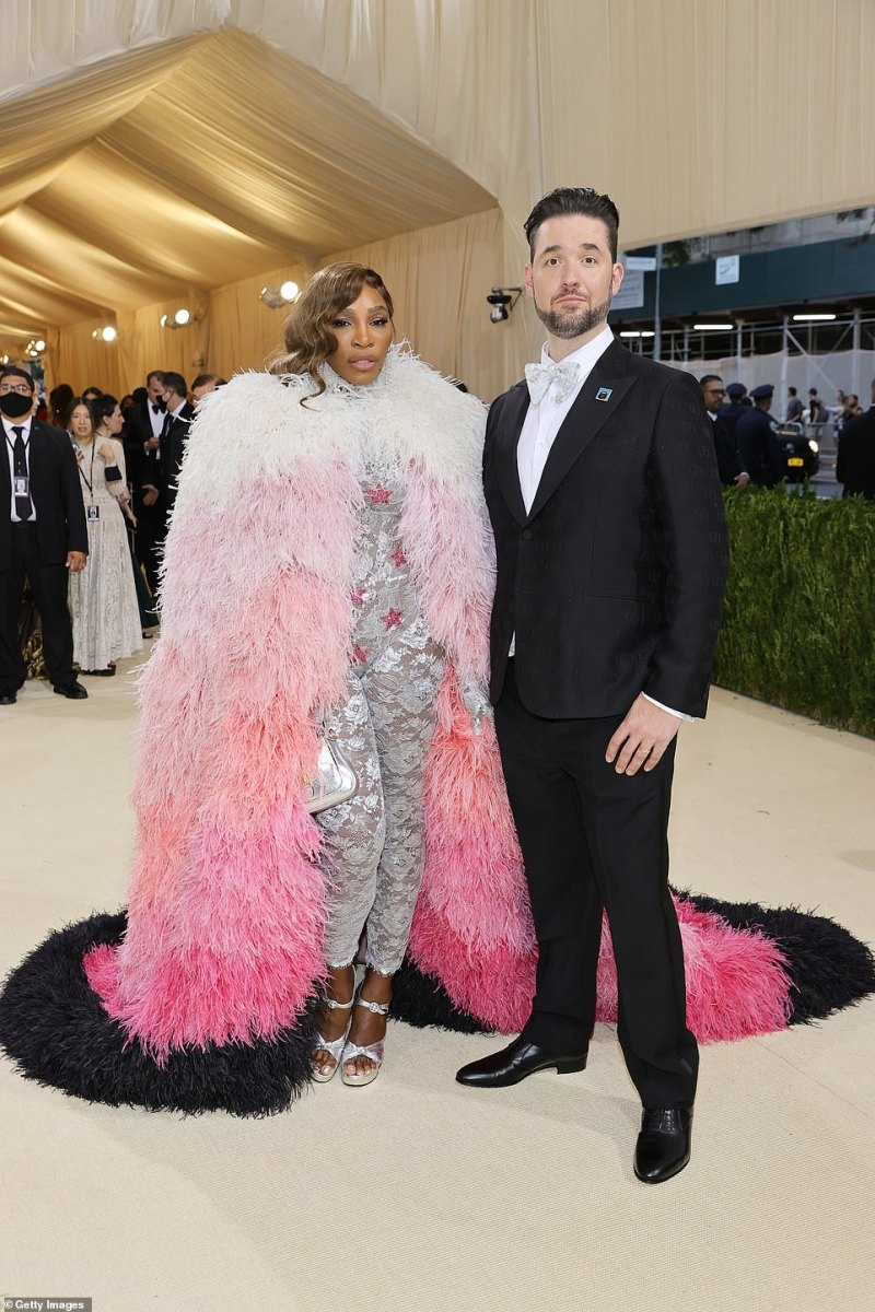 Fashion date night: Serena Williams donned a feathered black, pink and white jacket with a silver lace jumpsuit for the Met Gala; she arrived with her husband Alexis Ohanian