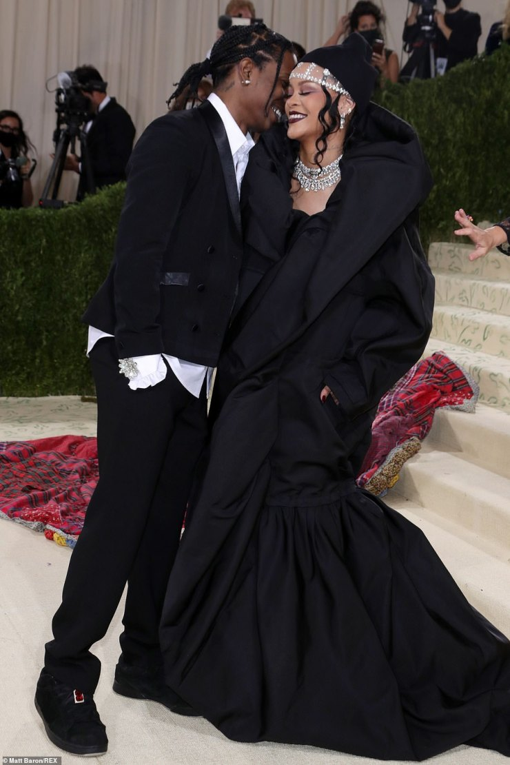 A moment: The couple cuddled on the red carpet as they giggled together