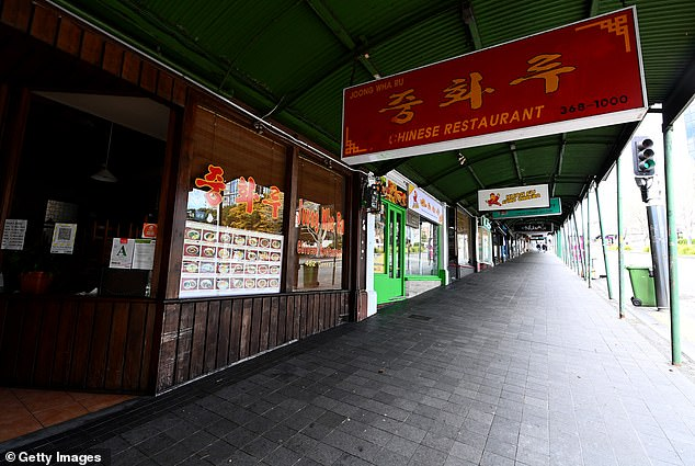 Ms Ardern said the country's strict 'zero Covid' strategy had helped bring the latest outbreak under control but that 'we haven't quite finished the job yet' (pictured, a closed restaurant in Auckland on Monday)