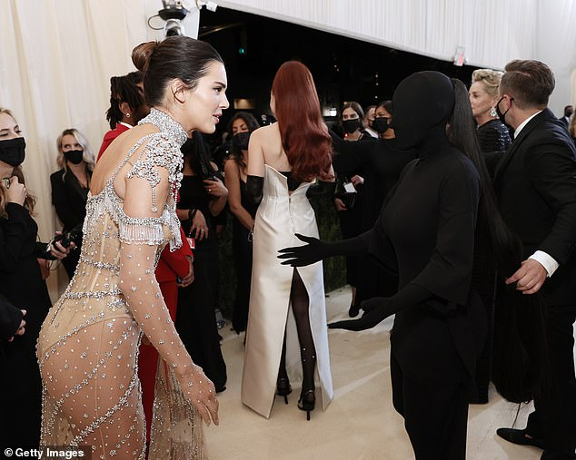 Interesting: Kendall and Kim chatted at the event making for quite the interesting snap