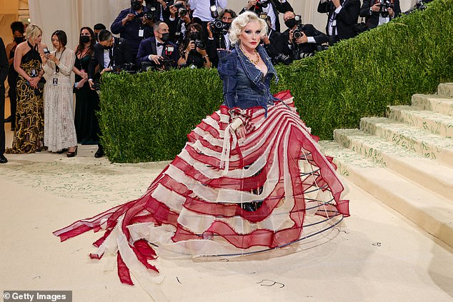 One of a kind: The bell-shaped skirt of red and white stripes resembled a tattered American flag with its colors attached to a wire-like frame; the blue denim jacket representedthe blue section of the American flag, albeit, without the white stars