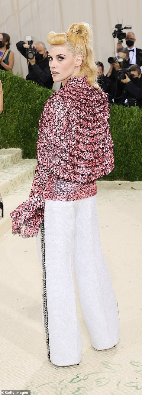 Kristen Stewart opted for trousers with a pleated top - both by Chanel