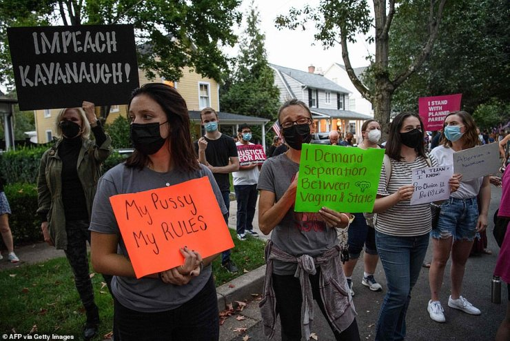 Protestors gathered outside of Justice Kavanaugh's home with signs to protest his recent rejection of a challenge to the Texas abortion law