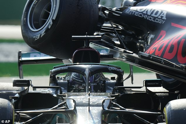 The rear end of Verstappen's Red Bull came within inches of Hamilton's head after the collision