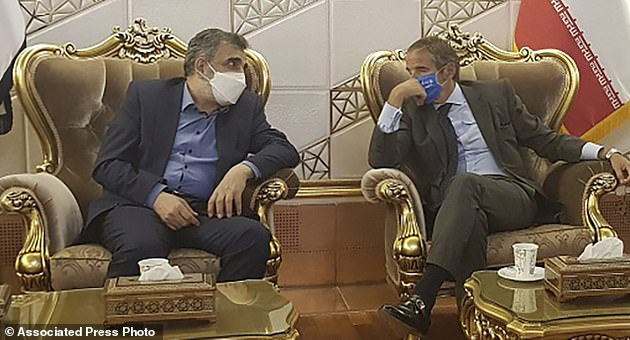 Iran is just one month away from amassing sufficient nuclear fuel to create a single nuclear weapon, Pictured: Director General of International Atomic Energy Agency, IAEA, Rafael Mariano Grossi, right, speaks with Deputy Head of the Atomic Energy Organization of Iran, Behrouz Kamalvandi, left