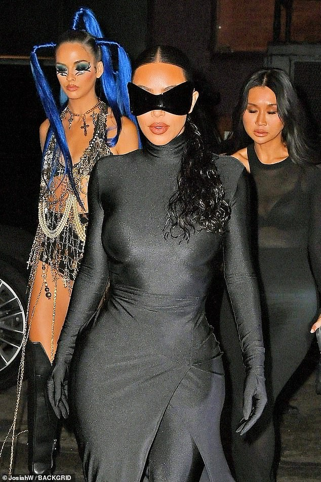 Posse:The estranged wife of Kanye West was later photographed arriving to the party with her posse trailing behind her