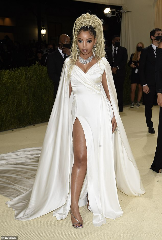 Pristine look:Chloe stepped out in a pristine white gown with a slit up the right leg, with a flowing white train behind her