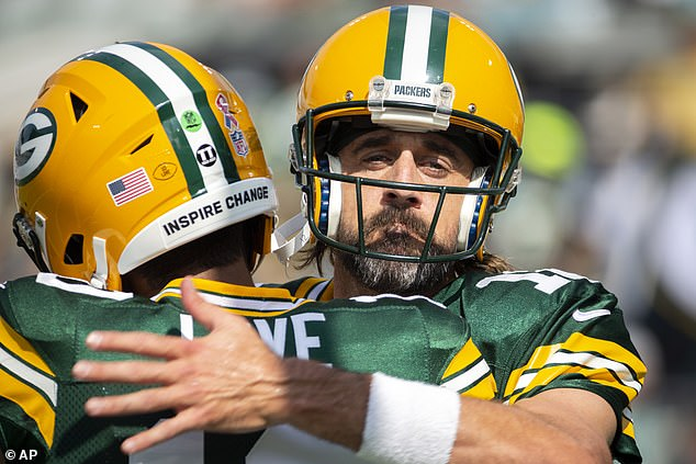 Aaron Rodgers (right) embraces Jordan Love, the man drafted to replace him, on a rough day for the reigning MVP