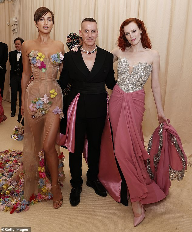 Pretty in pink:The two also posed with Karen Elson, who wore a sparkling jeweled off-the-shoulder top with a pink skirt to complement Jeremy's jacket