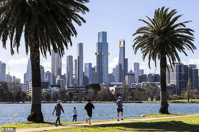People exercise at Albert Park Lake in Melbourne, Victoria during lockdown