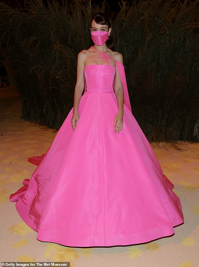 Safety first: The look even included a matching pink face covering, to ensure Carey was kept safe, as well as stylish