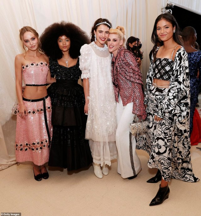 Emma posed for snaps alongside a host of A-listers, including Lily-Rose Depp, Whitney Peak, Margaret Qualley, Kristen Stewart (pictured l-r)