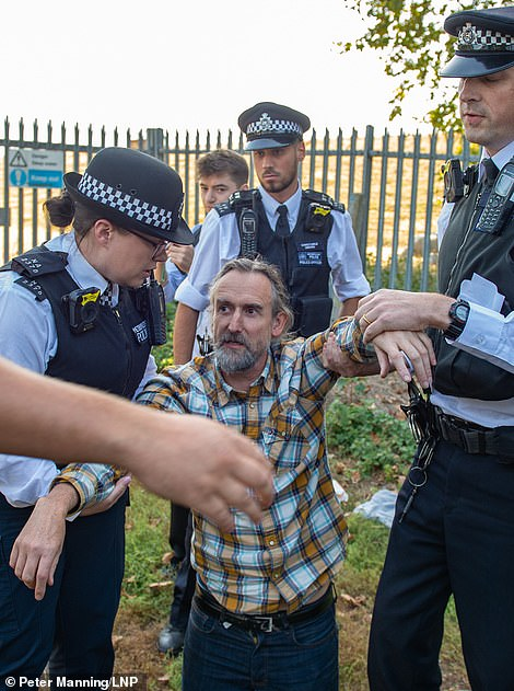 Farmer Roger Hallam, 55, who helped found Extinction Rebellion before leaving to joining protest organiser Insulate Britain (pictured at a Heathrow protest)
