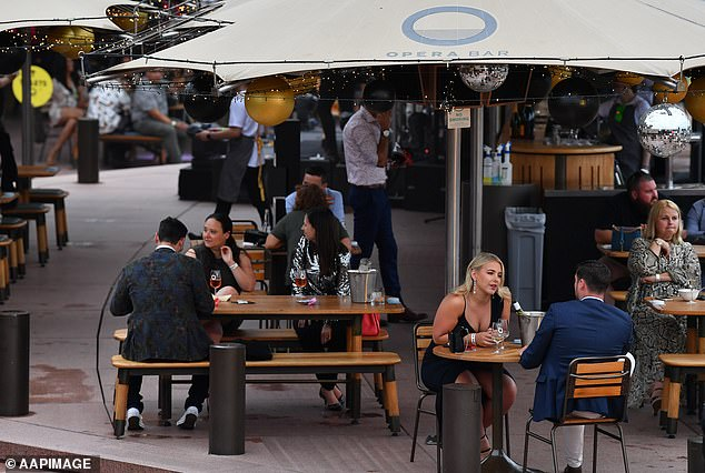The state is set to emerge from its gruelling lockdown in mid October when vaccination rates hit 70 per cent coverage Pictured: Patrons at Sydney's Opera Bar