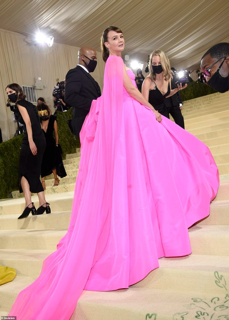 Standout: The actress looked exquisite in the bright Valentino Haute Couture gown from the Fall Winter 21/22 – Des Ateliers collection as she arrived at the star-studded fashion event